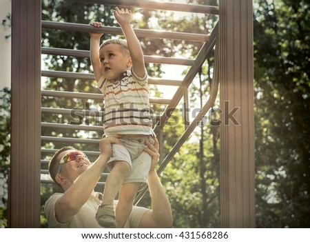 Father and son exercising outdoor.