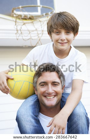 Father And Son Family Playing Basketball Outside Garage - stock photo