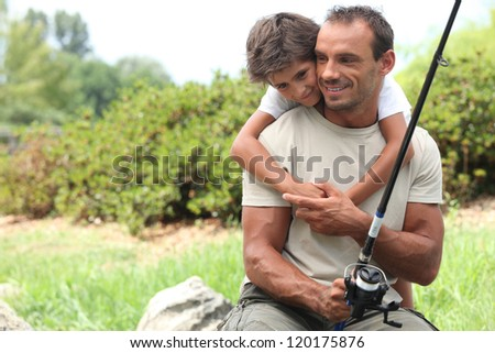Father and son fishing - stock photo