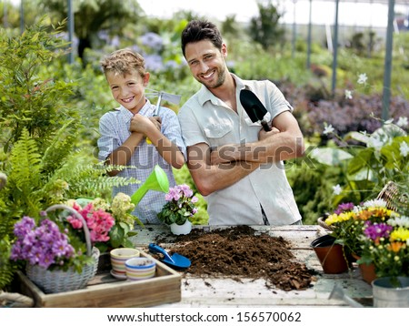 father and son gardening - stock photo