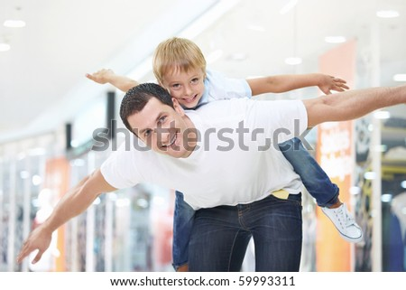 Father and son have fun in store - stock photo