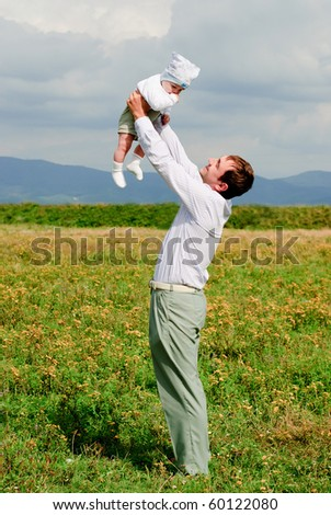 Father and son have fun outdoors - stock photo