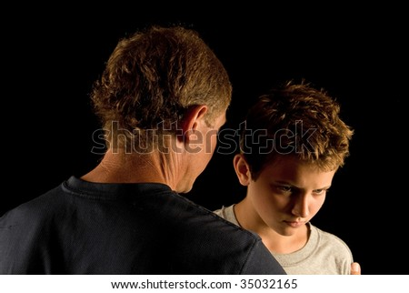Father and son having argument or disagreement - a serious talk - stock photo