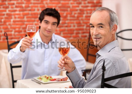 Father and son having lunch