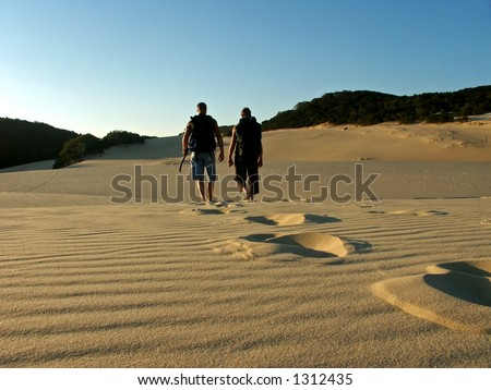 father and son hiking fraser island dunes near lake wobby in australia