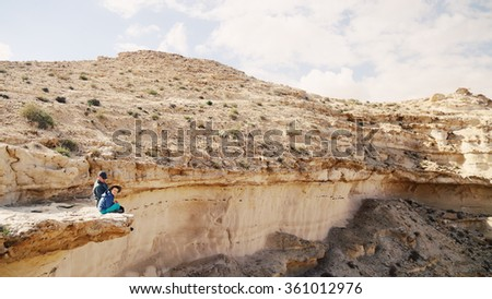 father and son hiking together - stock photo