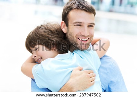Father and son hugging  - stock photo