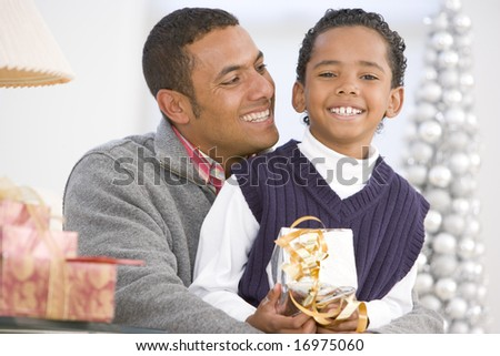 Father And Son Hugging,Holding Christmas Gift
