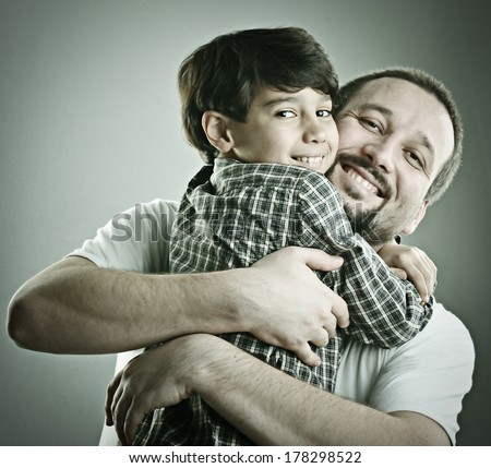 Father and son hugging in love - stock photo
