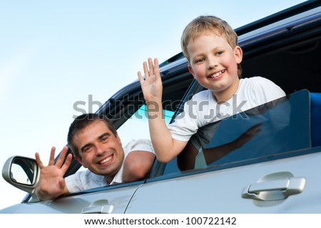 father and son in  the car - stock photo