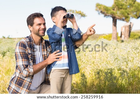 Father and son on a hike together on a sunny day - stock photo