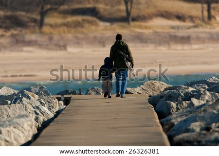 Father and son on pier - stock photo