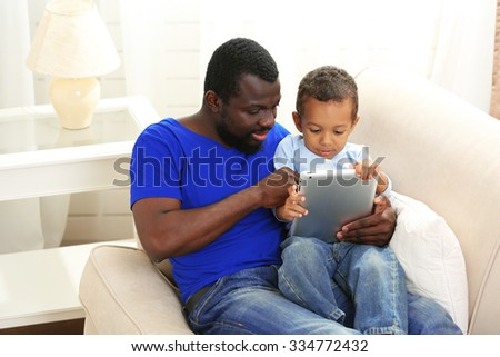 Father and son on sofa in the room