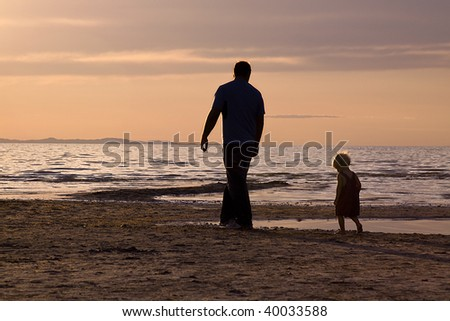 Father and Son on the Beach - Silhouette Shot - stock photo