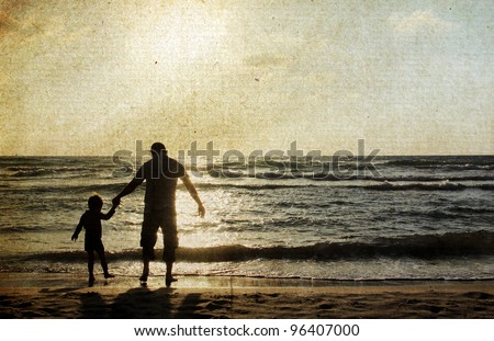father and son on the sea. Photo in old color image style. - stock photo