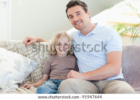 Father and son on the sofa