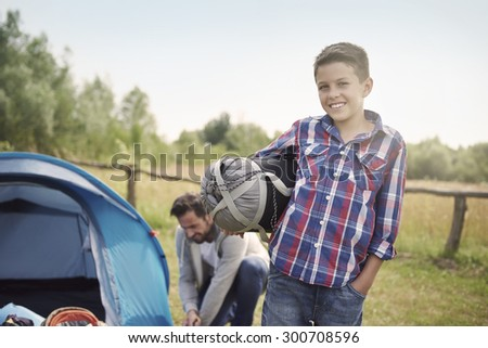 Father and son pitching a tent - stock photo