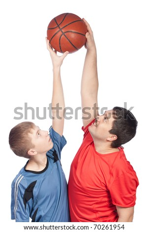 Father and son playing basketball, isolation - stock photo