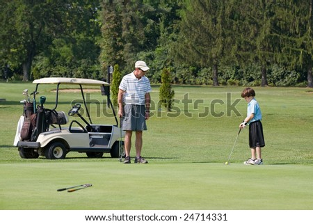 Father and Son Playing Golf - stock photo