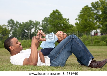 Father and Son Playing Outdoor Park in Summer - stock photo