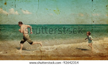 father and son playing together on the beach.  Photo in old image style. - stock photo