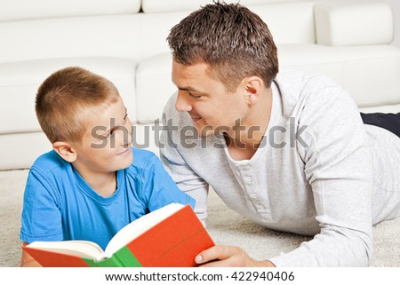 Father and son reading in the living room