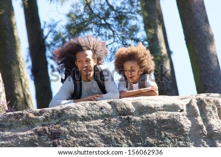 Father And Son Resting On Hike Through Countryside - stock photo