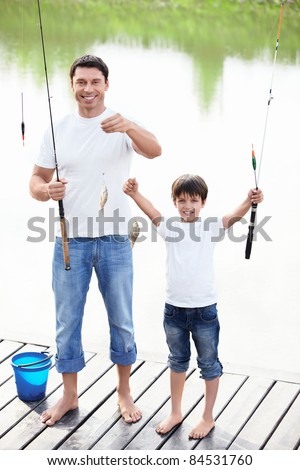 Father and son show catch - stock photo