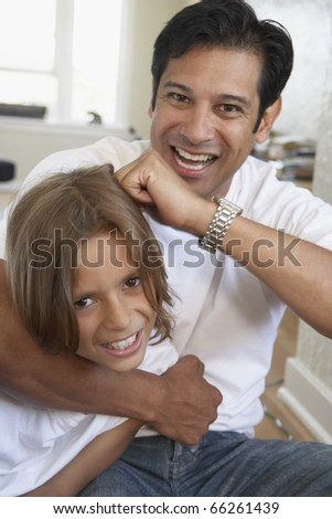 Father and son smiling for the camera