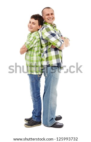 Father and son standing back to back isolated on white background - stock photo