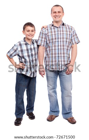 Father and son standing next to each other, isolated on white background - stock photo