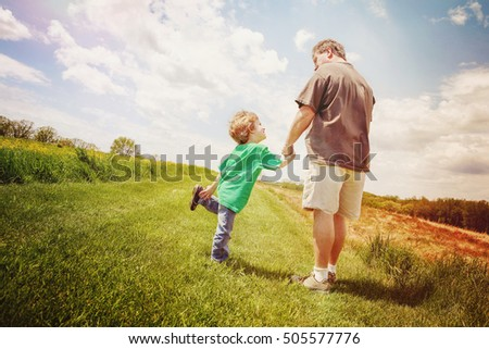Father and son taking a walk outside