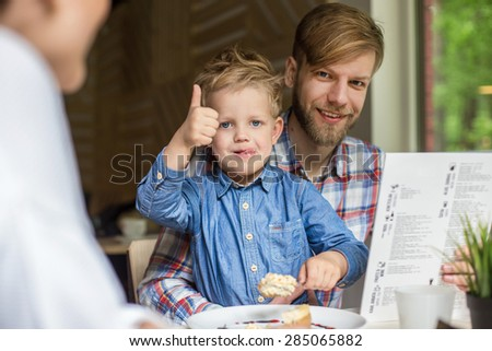 Father and son together in cafe. Family. Father's Day. Indoor portrait - stock photo