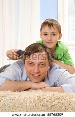 father and son together on the carpet - stock photo