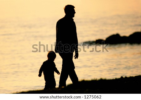 Father and Son walking by the sea - stock photo