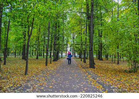 Father and son walks in the Park. Autumn - stock photo