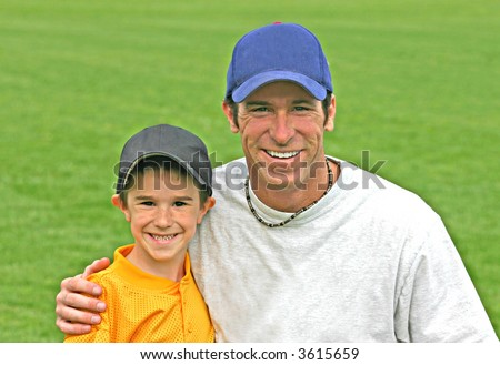 Father and Son Wearing Baseball Hats - stock photo