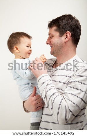 Father and son wearing pajamas - stock photo