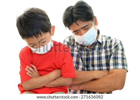 Father and son with a cold - stock photo