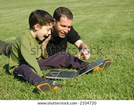 Father and son with laptop - stock photo