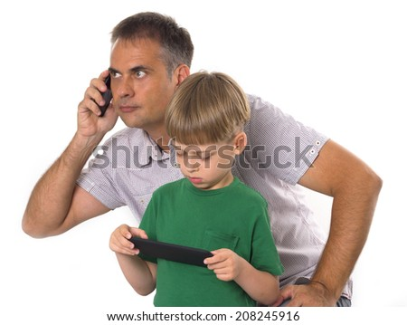 father and son with their gadgets - stock photo