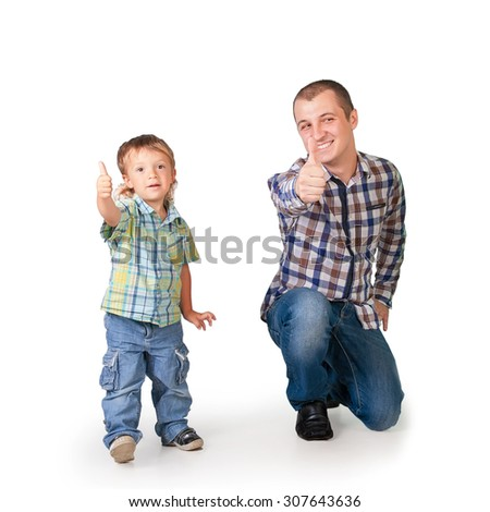 Father and son with thumbs up isolated on white - stock photo