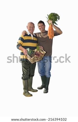 Father and son with vegetables, portrait, cut out - stock photo