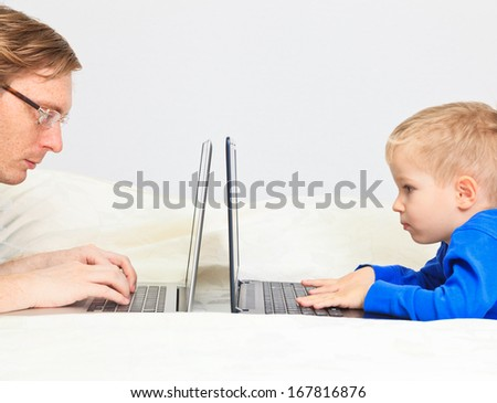 father and son working from home