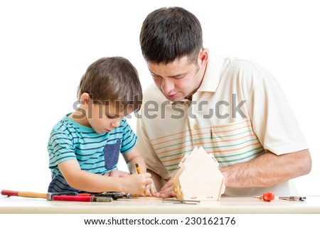 Father and son working together isolated on white