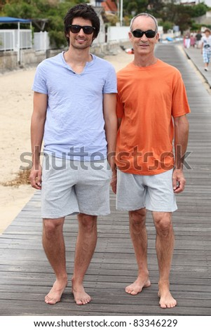 Father and sun stood on promenade - stock photo