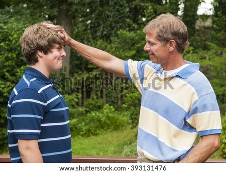 Father and teenage son being playful, having fun together