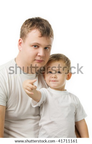 father and the son sit in white T-shirts, the child show a finger at something, isolated on white