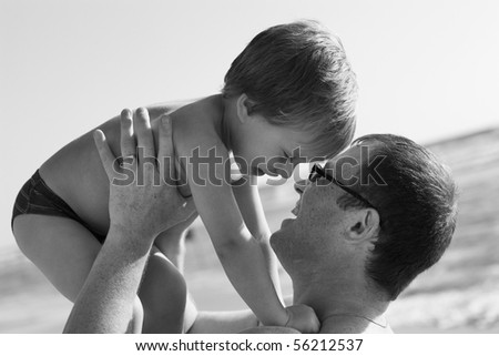 father at the beach with his child - stock photo