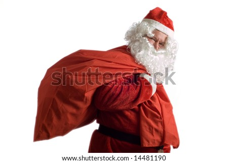 Father Christmas carries a red sack of presents over his shoulder - stock photo
